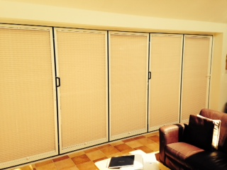 Tention Pleated blinds on bi fold doors